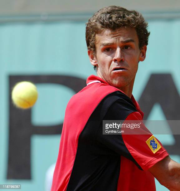 Gustavo Kuerten in action at the 2004 French Open men's second round at Roland Garros in Paris France on Thursday May 27 2004 Kuerten defeated Gilles...