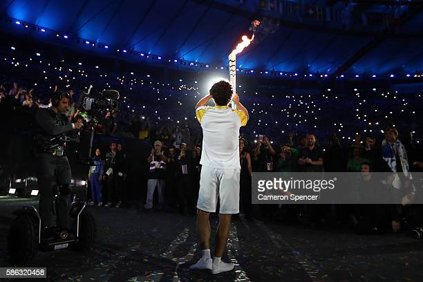 Gustavo Kuerten of Brazil carries the Olympic torch during the Opening Ceremony of the Rio 2016 Olympic Games at Maracana Stadium on August 5, 2016...