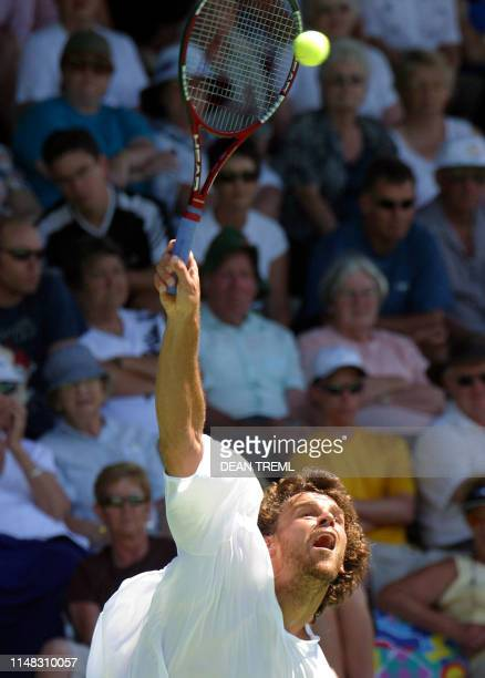 Gustavo Kuerten of Brazil in action during his second round singles match against Alberto Martin of Spain on day three of the Heineken Open mens...