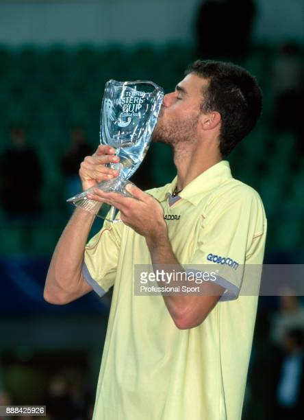 Gustavo Kuerten of Brazil kisses the trophy after defeating Andre Agassi of the USA in the Singles Final of the Tennis Masters Cup at the Pavilhão...