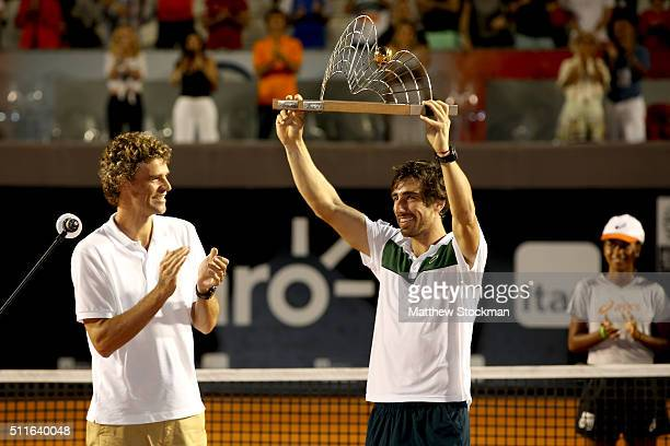Gustavo Kuerten of Brazil watches as Pablo Cuevas of Uraguay celebrates his win over Guido Pella of Argentina during the final of the Rio Open at...