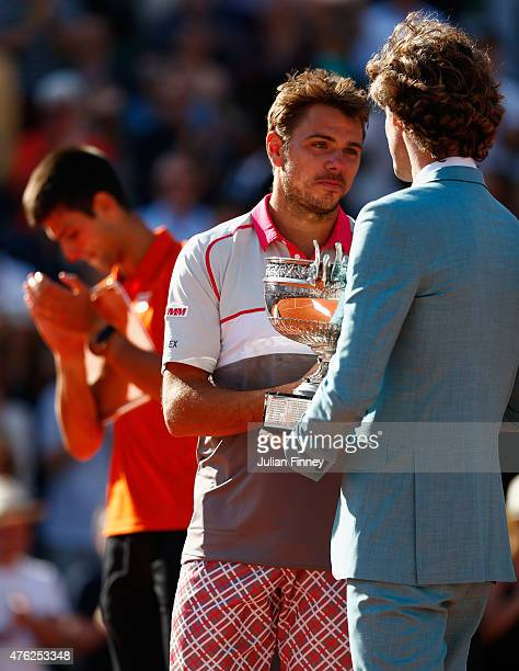 Gustavo Kuerten presents Stanislas Wawrinka of Switzerland with the Coupe de Mousquetaires after victory in the Men's Singles Final against Novak...