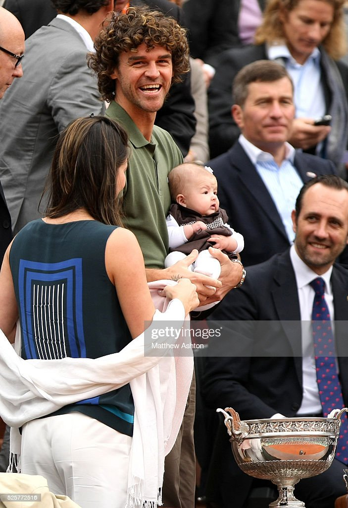 Gustavo Kuerten smiles with his baby before the Final at ...