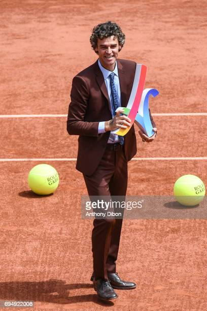 Gustavo Kuerten supporting the Paris 2024 Olympic bid during the day 15 of the French Open at Roland Garros on June 11 2017 in Paris France