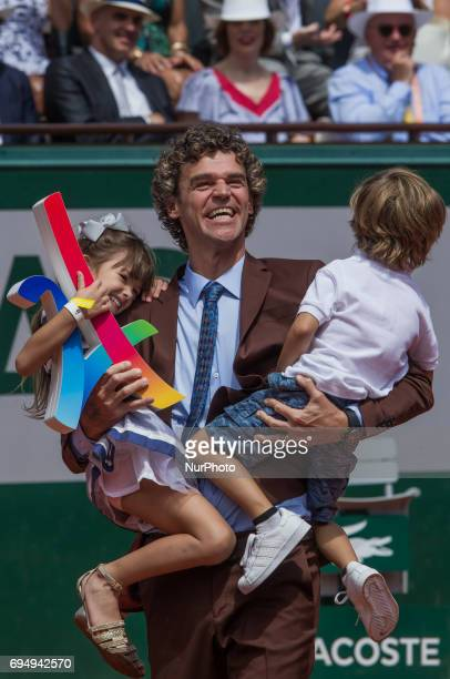 Gustavo Kuerten who has been given his Hall of Fame ring marking 20 years since the Brazilian won his first French Open title with his children...