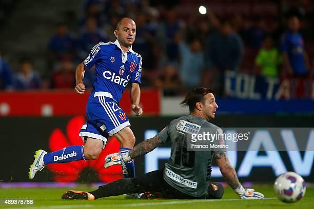 Gustavo Lorenzetti of U de Chile shots to score during a match between U de Chile and Cobreloa as part of fourteenth round of Torneo Scotiabank...