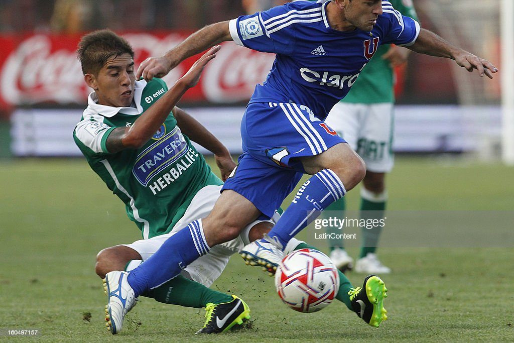Gustavo Lorenzetti of Universidad de Chile fights for the ball with Christian Jelvez of Audax Italiano during a match between Universidad de Chile and Audax Italiano as part of the Torneo Transición 2013 at Santa Laura Stadium on February 01, 2013 in Santiago, Chile.