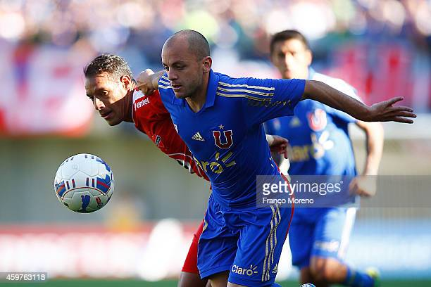 Gustavo Lorenzetti of Universidad de Chile fights for the ball with Juan Gonzalo Lorca of Nublense during a match between Nublense and Universidad de...