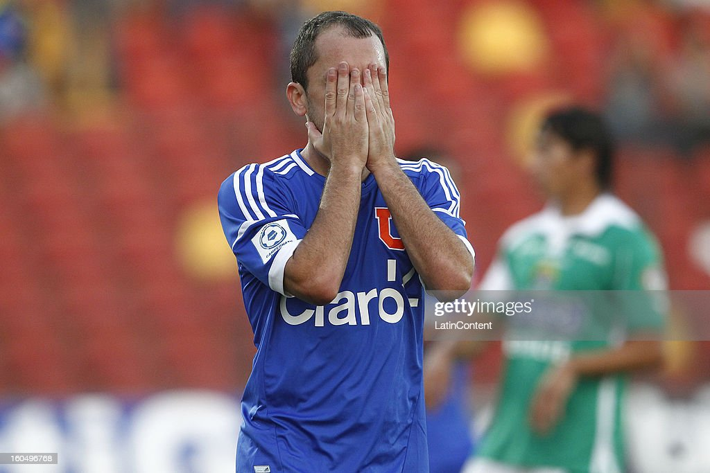 Gustavo Lorenzetti of Universidad de Chile gestures during a match between Universidad de Chile and Audax Italiano as part of the Torneo Transición 2013 at Santa Laura Stadium on February 01, 2013 in Santiago, Chile.