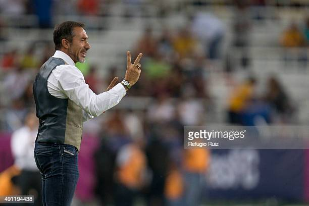 Gustavo Matosas coach of Atlas gives instructions to his players during the 12th round match between Atlas and Tigres UANL as part of the Apertura...