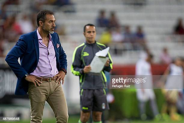 Gustavo Matosas coach of Atlas watches the match during an 8th round match between Atlas and Dorados de Sinaloa as part of the Apertura 2015 Liga MX...