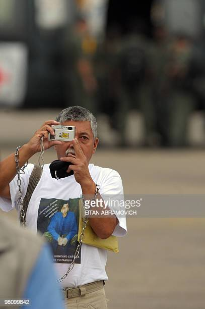Gustavo Moncayo, father of FARC hostage Colombian Army Corporal Pablo Emilio Moncayo, takes pictures before the start of the airborne operation to...