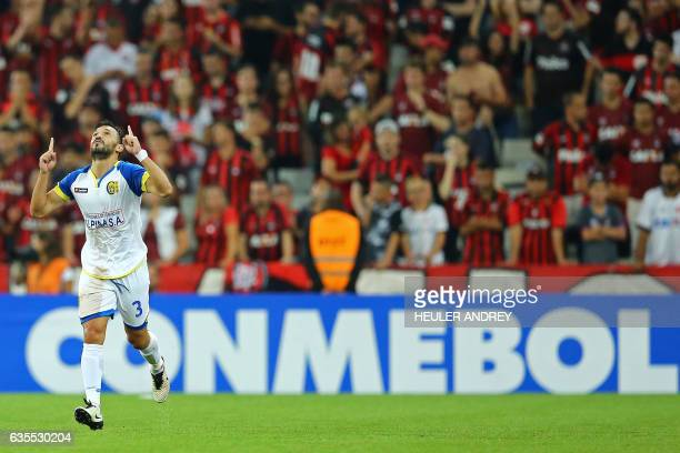 Gustavo Noguera of Paraguay's Deportivo Capiata celebrates a goal he scored against Brazil's Atletico Paranaense during their Libertadores Cup...