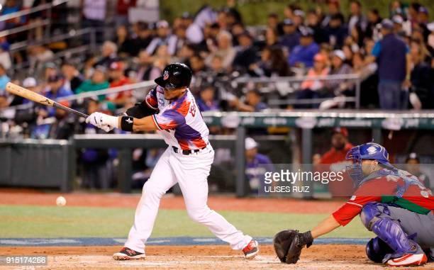 Gustavo Nunez of Aguilas Cibaenas of Republica Dominicana bats against Tomateros de Culiacan of Mexico during the Caribbean Baseball Series at...