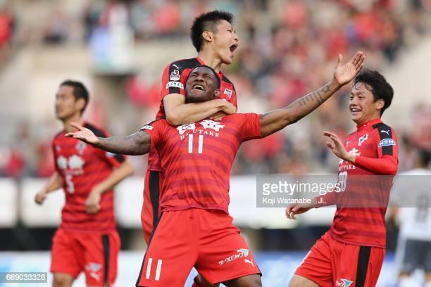 Gustavo of Roasso Kumamoto celebrates scoring the opening goal wiith his team mates during the J.League J2 match between Roasso Kumamoto and...