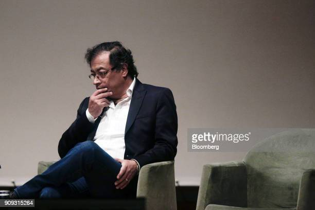 Gustavo Petro presidential candidate for the Progressivists Movement Party listens during a National Environmental Forum discussion in Bogota...