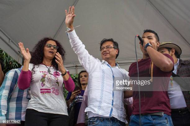 Gustavo Petro presidential candidate for the Progressivists Movement Party center waves during a campaign rally in Medellin Colombia on Friday Feb 16...