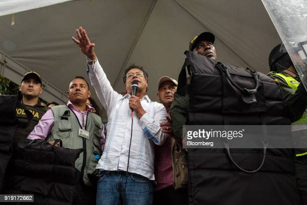 Gustavo Petro presidential candidate for the Progressivists Movement Party third left speaks while surrounded by police officers during a campaign...