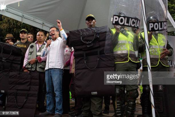 Gustavo Petro presidential candidate for the Progressivists Movement Party fourth left speaks while surrounded by police officers during a campaign...