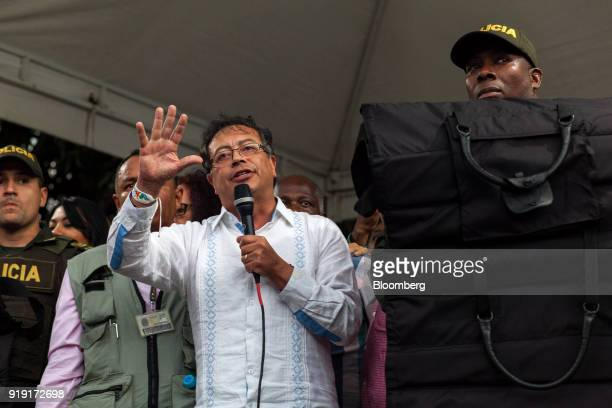 Gustavo Petro presidential candidate for the Progressivists Movement Party center speaks while surrounded by police officers during a campaign rally...