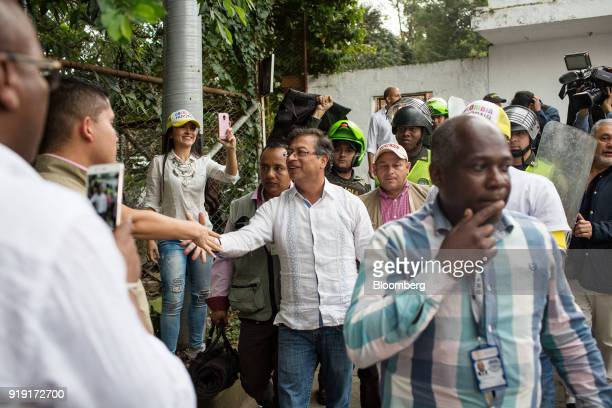 Gustavo Petro presidential candidate for the Progressivists Movement Party center greets attendees as he arrives at a campaign rally in Medellin...