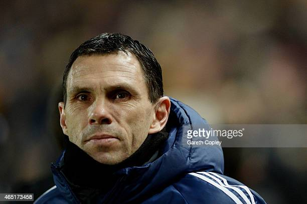 Gustavo Poyet the manager of Sunderland looks on during the Barclays Premier League match between Hull City and Sunderland at the KC Stadium on March...