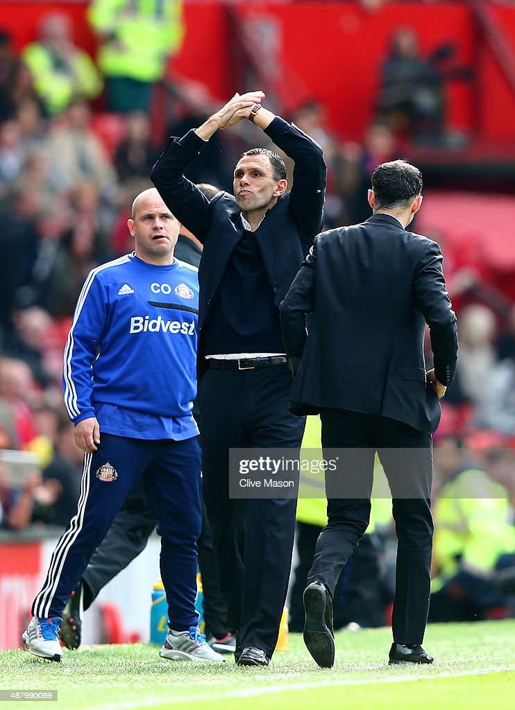Gustavo Poyet the Sunderland manager celebrates his team's 1-0 victory during the Barclays Premier League match between Manchester United and Sunderland at Old Trafford on May 3, 2014 in Manchester, England.