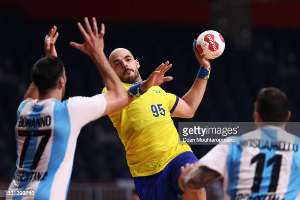 Gustavo Rodrigues of Team Brazil passes the ball whilst Nicolas Bonanno and Lucas Dario Moscariello of Team Argentina defend during the Men's...