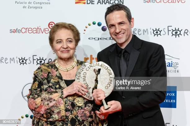 Gustavo Salmeron and her mother receive the Best Documentary film Award for the movie 'Muchos hijos un mono y un castillo' at the 23rd edition of...