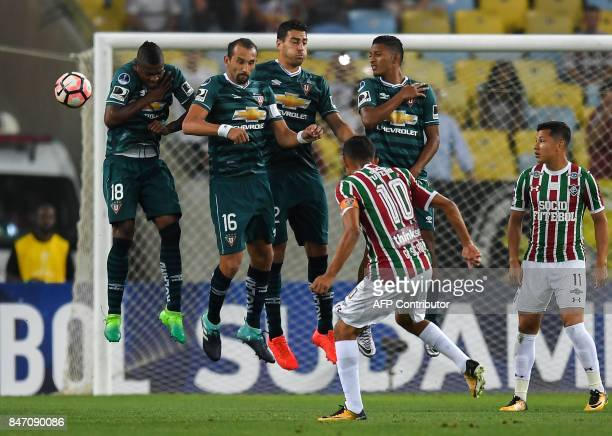 Gustavo Scarpa of Brazil's Fluminense kicks to score against Ecuador's Liga de Quito during their 2017 Sudamericana Cup football match held at the...