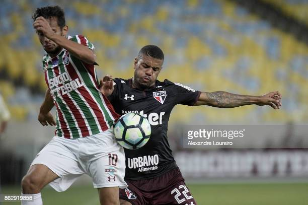 Gustavo Scarpa of Fluminense battles for the ball with Júnior Tavares of Sao Paulo during the match between Fluminense and Sao Paulo as part of...
