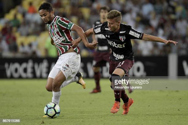 Gustavo Scarpa of Fluminense battles for the ball with Lucas Fernandes of Sao Paulo during the match between Fluminense and Sao Paulo as part of...