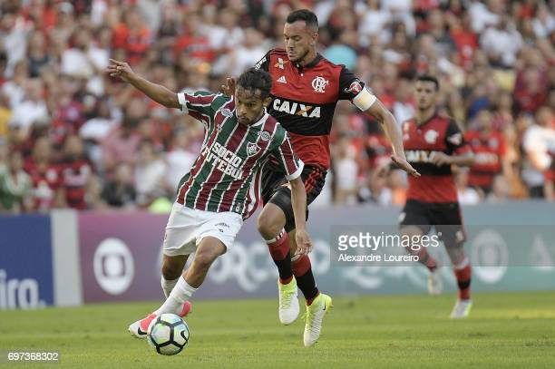 Gustavo Scarpa of Fluminense battles for the ball with Rever of Flamengo during the match between Fluminense and Flamengo as part of Brasileirao...