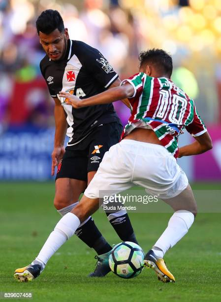 Gustavo Scarpa of Fluminense struggles for the ball with Andres Rios of Vasco da Gama during a match between Fluminense and Vasco da Gama as part of...