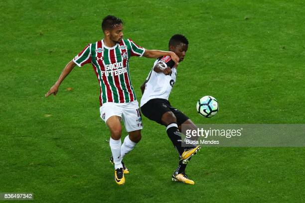 Gustavo Scarpa of Fluminense struggles for the ball with Cazares of Atletico MG during a match between Fluminense and Atletico MG part of Brasileirao...