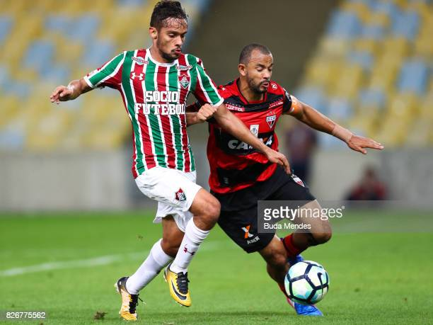 Gustavo Scarpa of Fluminense struggles for the ball with Diego Rosa of Atletico GO during a match between Fluminense and Atletico GO as part of...