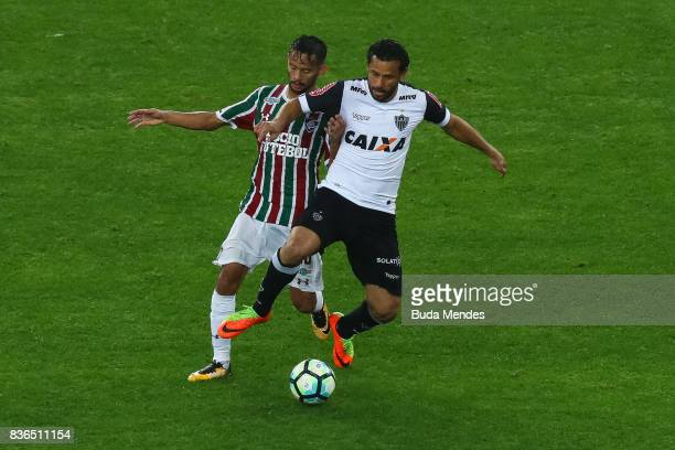 Gustavo Scarpa of Fluminense struggles for the ball with Fred of Atletico MG during a match between Fluminense and Atletico MG part of Brasileirao...