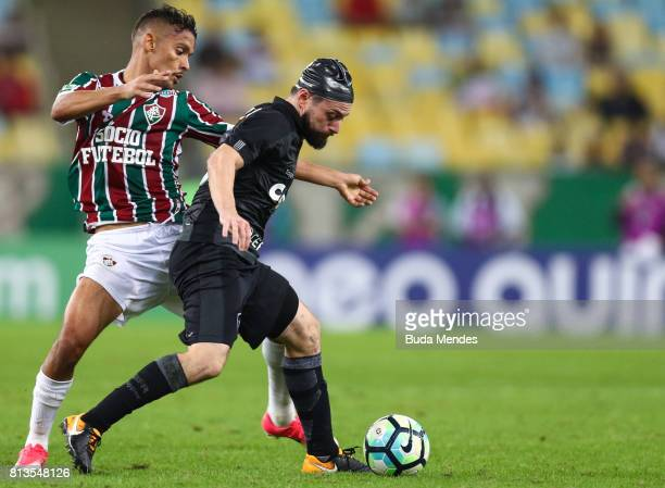 Gustavo Scarpa of Fluminense struggles for the ball with Joao Paulo of Botafogo during a match between Fluminense and Botafogo as part of Brasileirao...