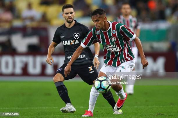 Gustavo Scarpa of Fluminense struggles for the ball with Rodrigo Pimpao of Botafogo during a match between Fluminense and Botafogo as part of...