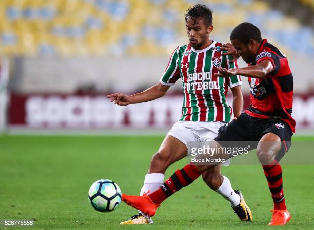 Gustavo Scarpa of Fluminense struggles for the ball with Silva of Atletico GO during a match between Fluminense and Atletico GO as part of...