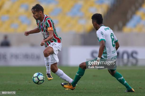 Gustavo Scarpa of Fluminense struggles for the ball with Tche Tche of Palmeiras during a match between Fluminense and Palmeiras as part of...