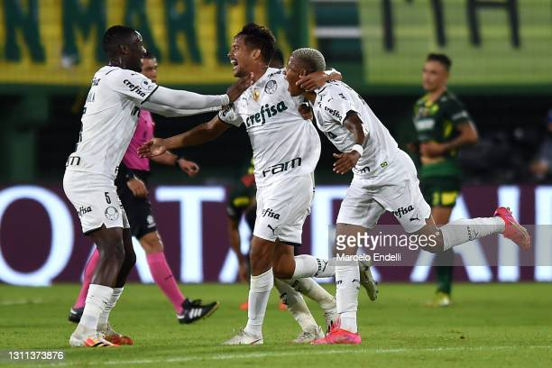 Gustavo Scarpa of Palmeiras celebrates after with teammates after scoring the second goal of his team during match between Defensa y Justicia and...
