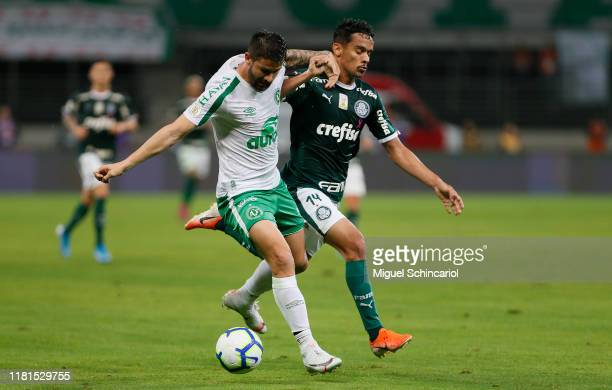 Gustavo Scarpa of Palmeiras vies the ball with Everaldo of Chapecoense during a match between Palmeiras and Chapecoense for the Brasileirao Series A...
