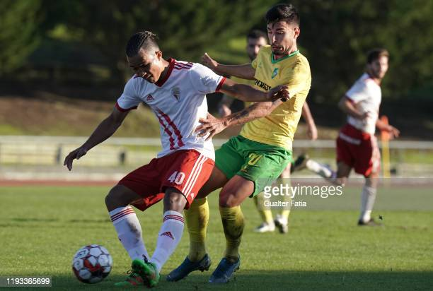 Gustavo Tocantins of UD Vilafranquense with Nuno Tavares of CD Mafra in action during the Liga Pro match between CD Mafra and UD Vilafranquense at...