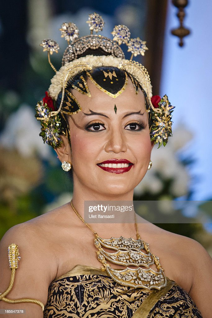 Gusti Kanjeng Ratu Hayu poses for a photograph during her wedding ceremony in Bangsal Kesatriyan at Kraton Palace on October 22, 2013 in Yogyakarta, Indonesia. The Royal Wedding Held For Sultan Hamengkubuwono X's Daughter Gusti Ratu Kanjeng Hayu And KPH Notonegoro. Wedding celebrations will take place October 21-23 October. The wedding parade will include 12 royal horse drawn carriages and will be streamed live on the internet so that it can be watched by people all over the world.