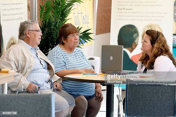 Gusto Guzman, left and his wife Gloria Guzman of Guadalupe, Arizona, talk with Connie Parra, right of El Mirage, Arizona to see if they need to make...