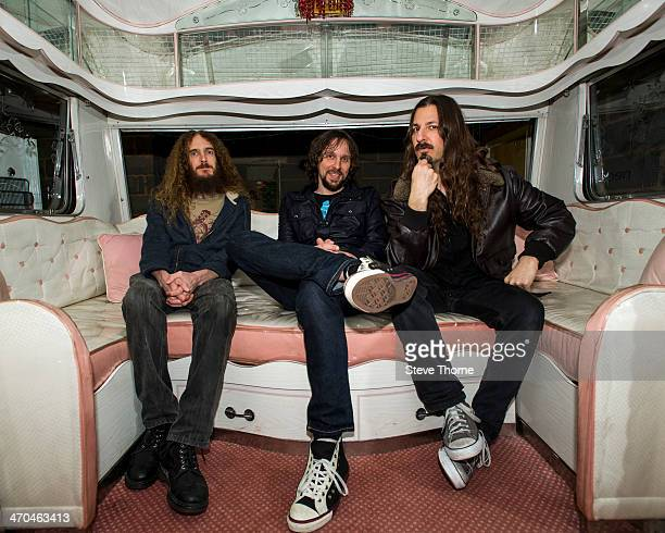 Guthrie Govan Marco Minneman and Bryan Beller of The Aristocrats pose backstage at the Assembly on February 19 2014 in Leamington Spa United Kingdom