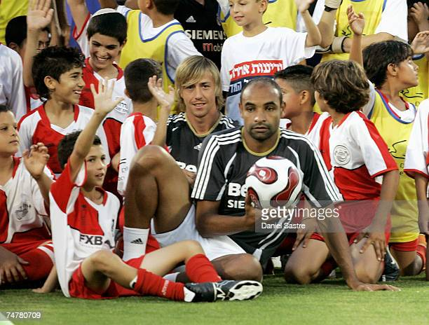 Guti and Emerson of Real Madrid pose with young players before a friendly match between Real Madrid and a Palestinian & Israeli XI at the Ramat Gan...