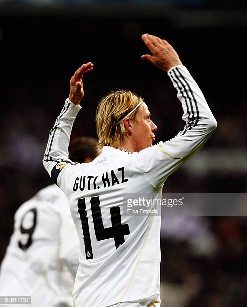 Guti of Real Madrid celebrates his team's first goal during the UEFA Champions League round of sixteen second leg match between Real Madrid and Lyon...