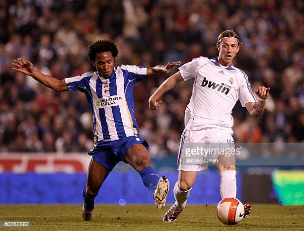 Guti of Real Madrid fights for the ball with Julian De Guzman of Deportivo la Coruna during the La Liga match between Deportivo La Coruna and Real...